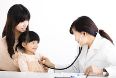 Female doctor examining a child patient Stock Photo