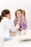 Female doctor examining child with stethoscope Royalty Free Stock Images