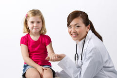 Female doctor examining child with stethoscope. Royalty Free Stock Photography
