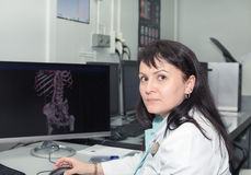 Female doctor examining an CT scanner results Stock Image
