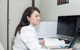 Female doctor examining an CT scanner results Royalty Free Stock Photos