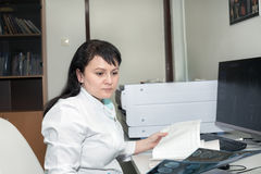 Female doctor examining CT scanner results Royalty Free Stock Photo