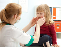 Female doctor examining little girl Stock Photo