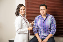 Female doctor examining a patient Royalty Free Stock Photo