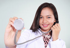 Female doctor is examining a patient with a stethoscope Royalty Free Stock Images