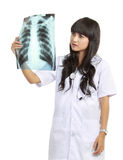 Female doctor examining an x-ray Stock Photography