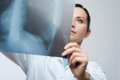 Female doctor examining x-ray image Royalty Free Stock Image