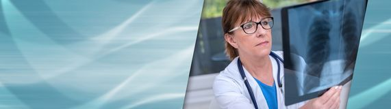 Female doctor examining x-ray report. panoramic banner. Female doctor examining x-ray report in medical office. panoramic banner stock photography