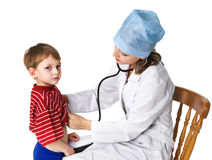 Female doctor examining sick boy Royalty Free Stock Photos