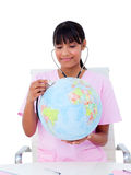 Female doctor examining a terrestrial globe Stock Photography