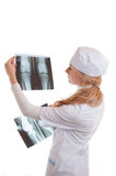 Female doctor examining x-ray Stock Photos