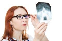 Female doctor examining X-ray image Royalty Free Stock Photography