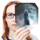 Female doctor examining X-ray image Stock Photos