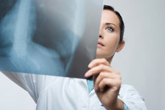 Female doctor examining x-ray image Royalty Free Stock Image