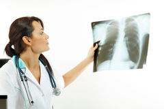 Female doctor examining an x-ray image Stock Image