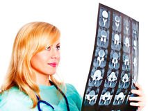 Female doctor examining x-ray picture over white Stock Photos