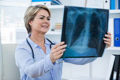 Female doctor examining x-ray report Royalty Free Stock Image