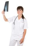 Female doctor examining an xray image Royalty Free Stock Photography