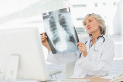 Female doctor examining xray in medical office Stock Images