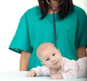 Female doctor exams baby boy Royalty Free Stock Photos