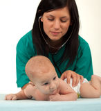 Female doctor exams baby boy Stock Image