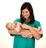 Female doctor exams baby boy Stock Photography