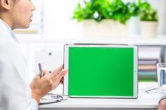 Female doctor explain with tablet stock photo