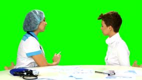 Female doctor explaining diagnosis to her female stock video