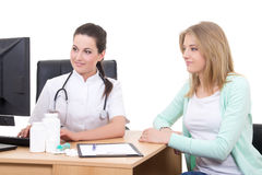 Female doctor explaining results to young patient in office Stock Image
