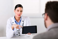 Female doctor explaining something to a patient stock photo
