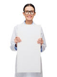 Female doctor in eyeglasses with white blank board. Healthcare, advertisement and medicine concept - smiling female doctor in eyeglasses with white blank board Stock Images
