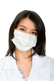 Female doctor with facemask Stock Photo