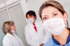Female doctor with facemask Royalty Free Stock Image