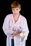Female doctor filling out prescription orders Stock Photography