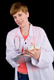 Female doctor filling out prescription orders Stock Photos