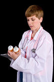Female doctor filling out prescription orders Royalty Free Stock Images