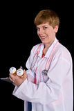 Female doctor filling out prescription orders Royalty Free Stock Photography