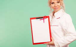 Female doctor with folder and pink ribbon Stock Photos