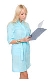 A female doctor with a folder, standing Stock Photos