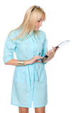 A female doctor with a folder, standing Royalty Free Stock Photography