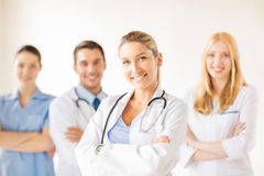 Female doctor in front of medical group Stock Images
