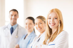 Female doctor in front of medical group Royalty Free Stock Images