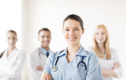 Female doctor in front of medical group Royalty Free Stock Photography