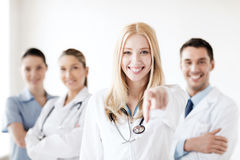 Female doctor in front of medical group Royalty Free Stock Image