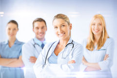 Female doctor in front of medical group Stock Photos
