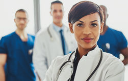 Female doctor in front of team Stock Photos