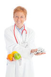 Female doctor with fruits and pills Royalty Free Stock Photography