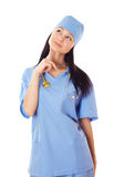 Female doctor. Full isolated studio picture from a young and beautiful smiling female doctor looking up Royalty Free Stock Photography