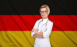 Female doctor and germany flag Royalty Free Stock Photos
