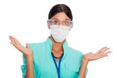 Female doctor gesturing do not know sign stock photos